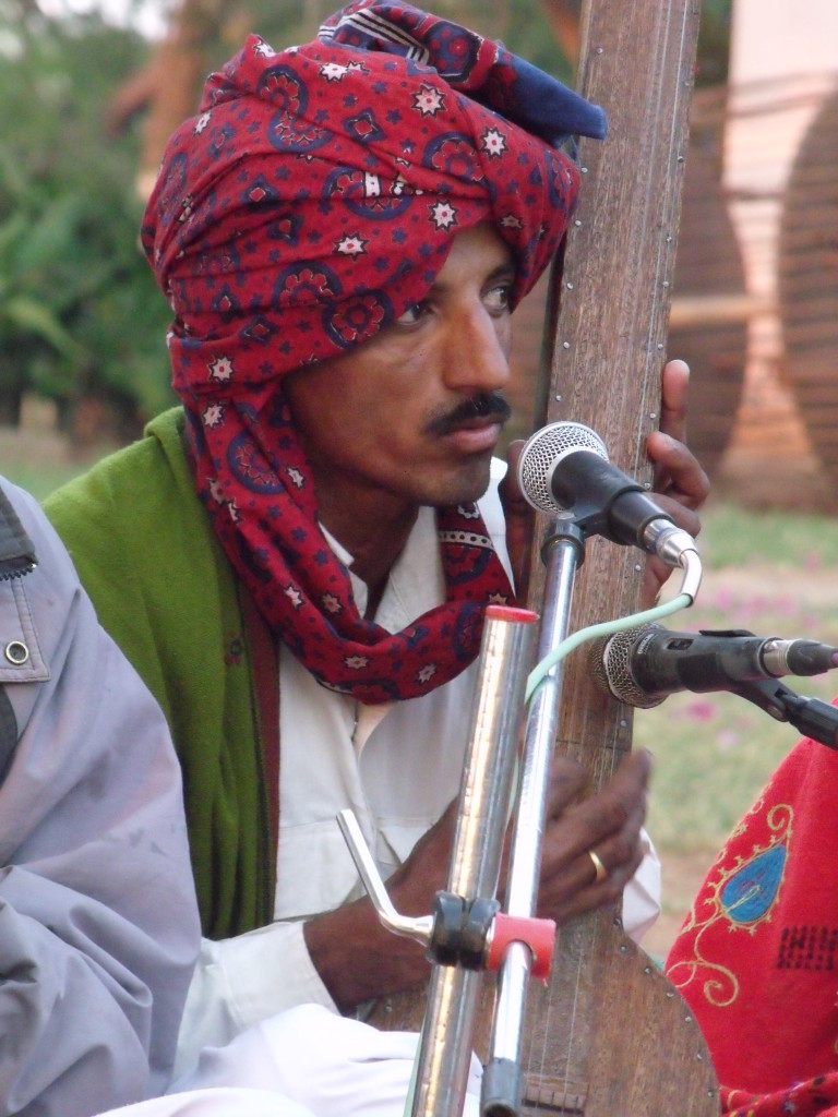 Musician wearing a chemical dyed ajrakh turban in Bhuj, 2011. Photograph: Ruth Clifford