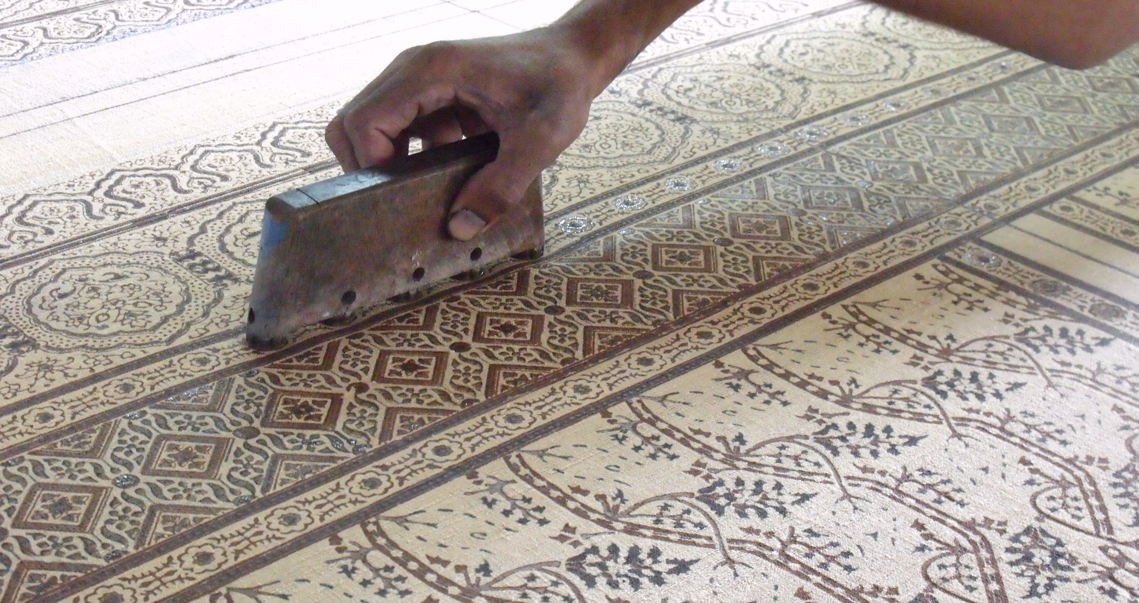 block printing a traditional ajrakh border with a Moroccan style ground