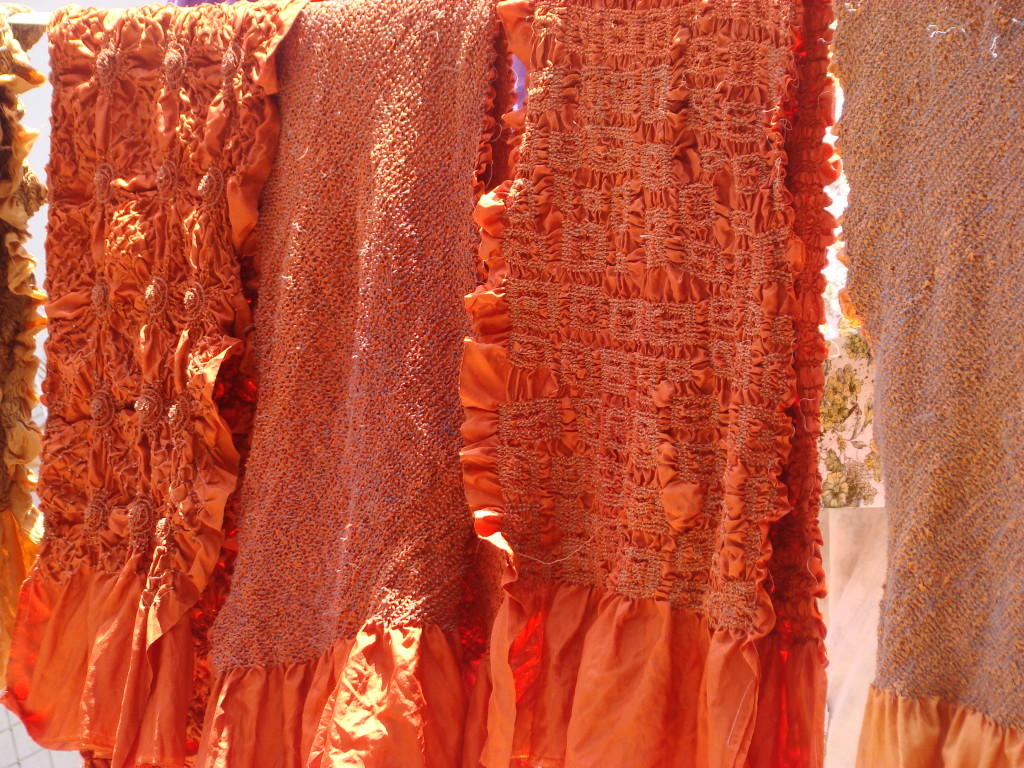 Some of Kamaldeep's vibrant orange bandhani scarves