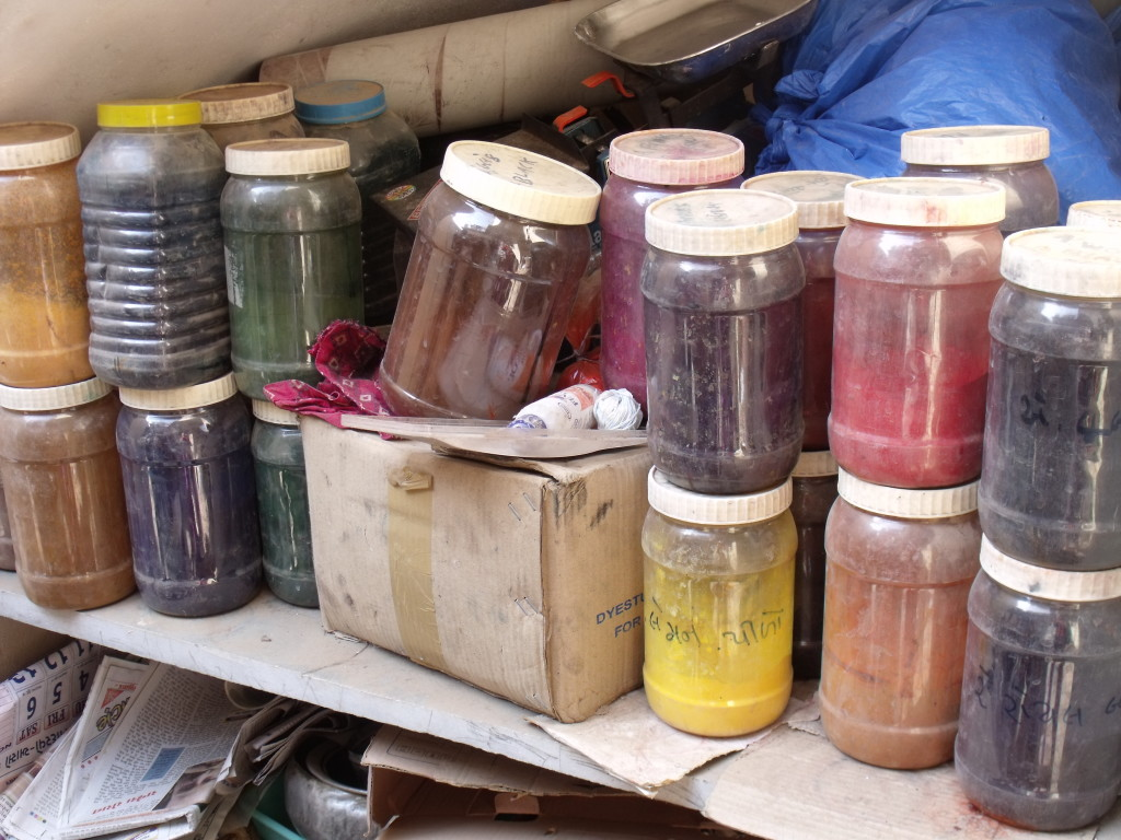 The shelf of dyes in Abduljabbar's workshop