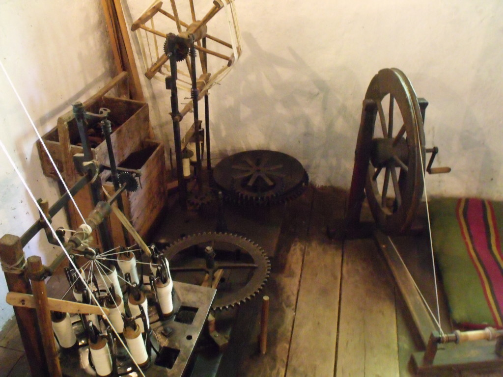 A braiding machine and a spinning wheel