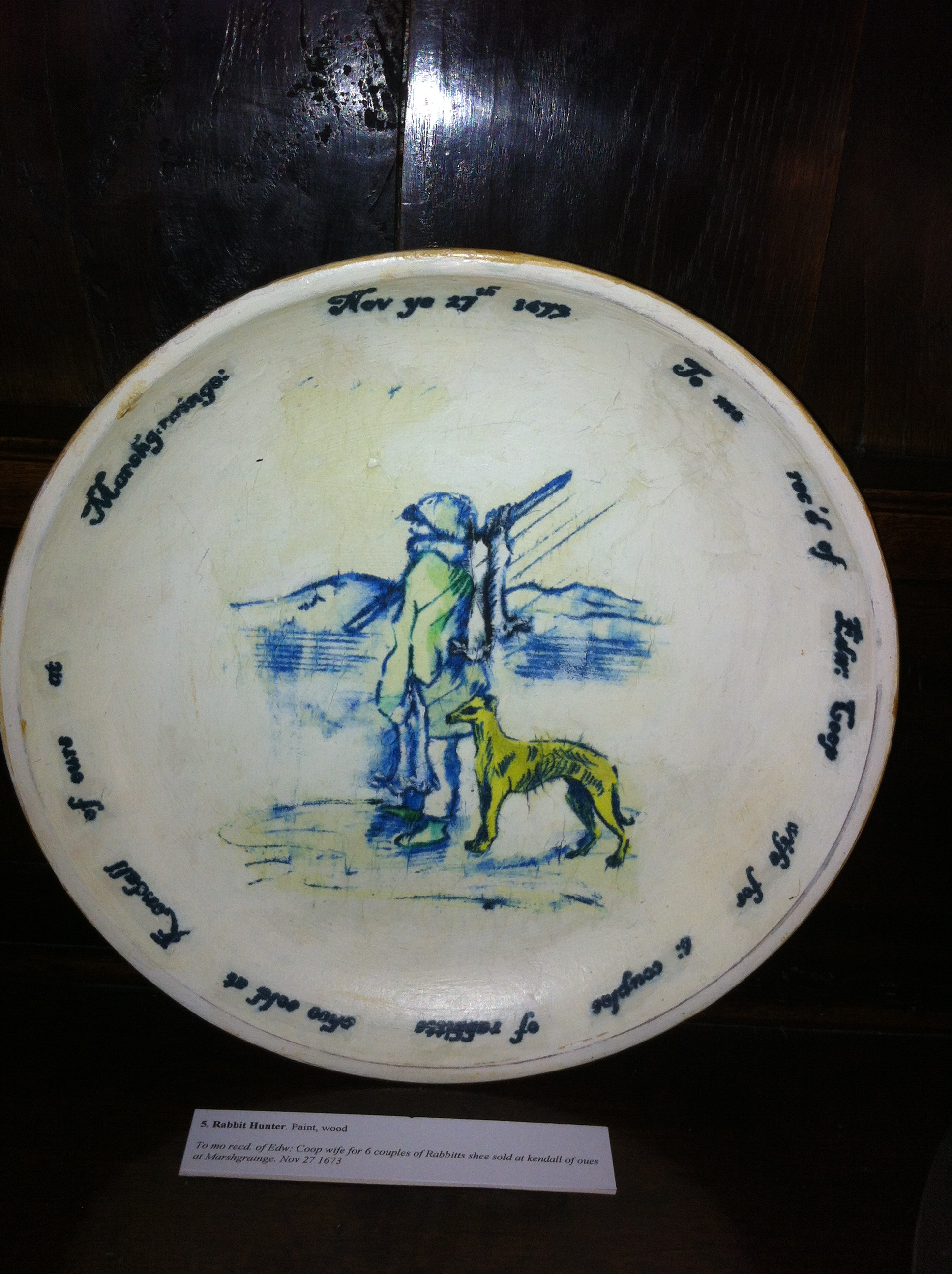 One of Denise's plates sits alongside traditional blue and white pottery on the dresser in the dining room