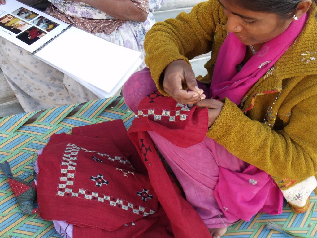 A Kala Raksha Vidhyalaya student doing suf embroidery