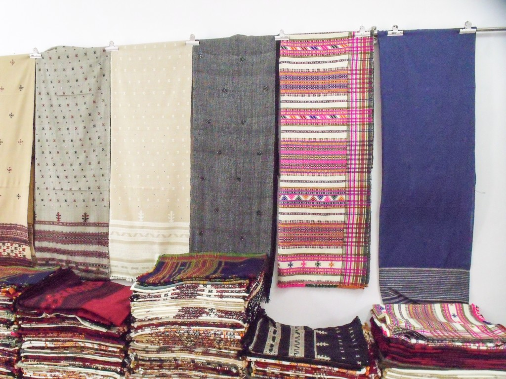 Traditional and contemporary shawls displayed in Shamji's shop