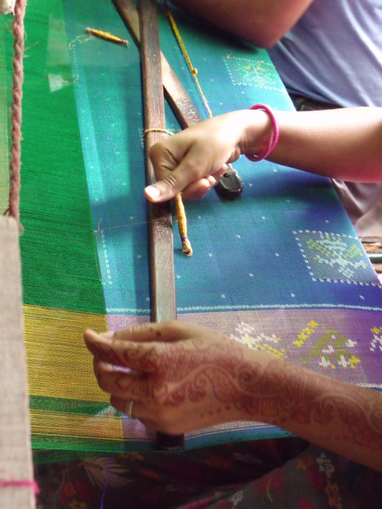 Single ikat weaving adding the imitation zari supplementary pattern