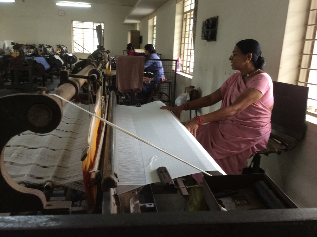 One of the ladies working at the loom