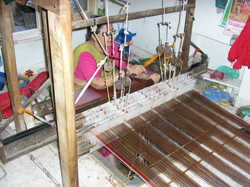A lady of the Salvi family at her loom in 2008