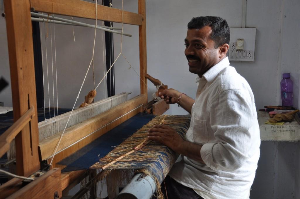 Shami weaving a heavily patterned piece