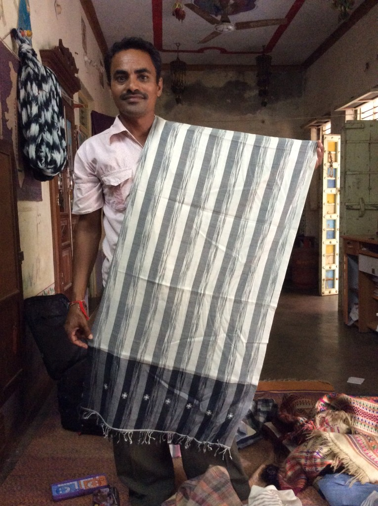 Ramji modelling one of his ikat woven scarves.