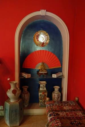 Niche in dining room displaying an array of Geeta's collected objects from around the world