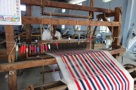 A handloom weaver weaving fabric for towels