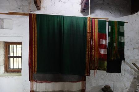 Ilkal saris displayed in a typical Karnataka style rural house.