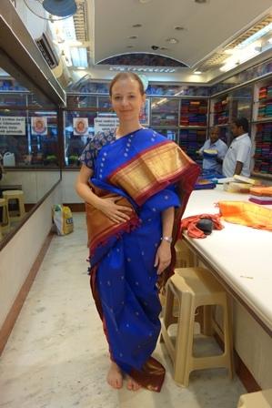 Trying on a Kanchipuram sari in the government sari store in Kanchipuram