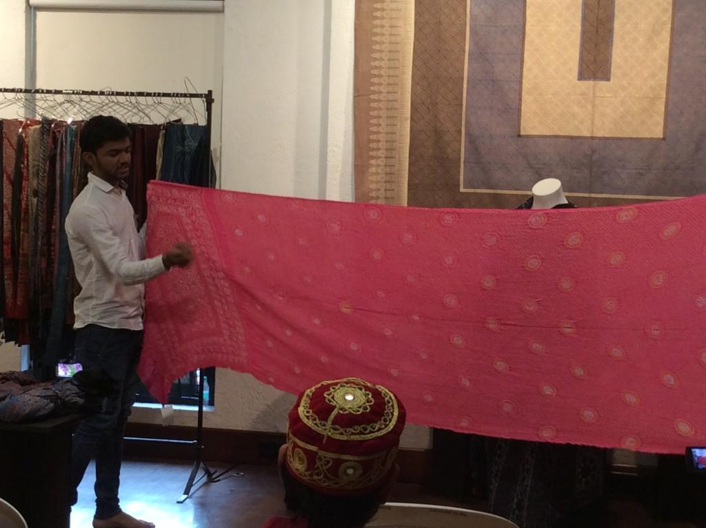 Saddik talking about one of his saris