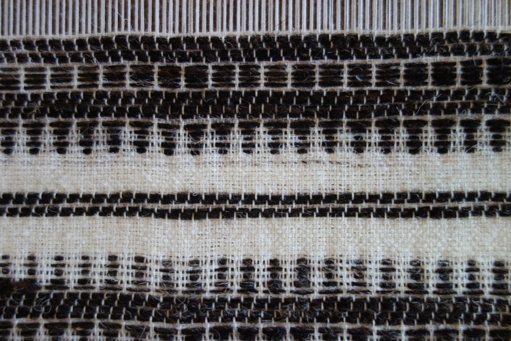 Close up of the patterns created using the varach - the first row (nearest to the lense) is created by lifting the first wooden stick every time, then there are two rows of lath and then popti