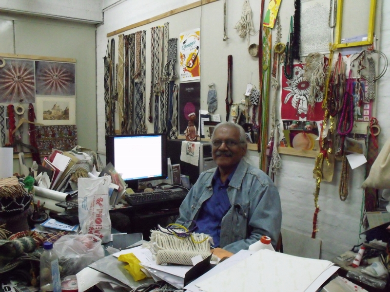 Errol in his colourful NID office/studio filled with his amazing ply-split braided creations and collections.