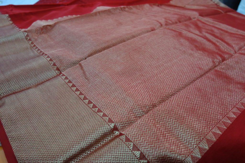 Zari boarder and pallu on a vibrant red sari