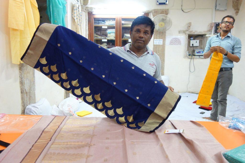 Farooq, Field-In-Charge at Chanderiyaan showing me a sari made specially for Bollywood actress Karina Kapoor