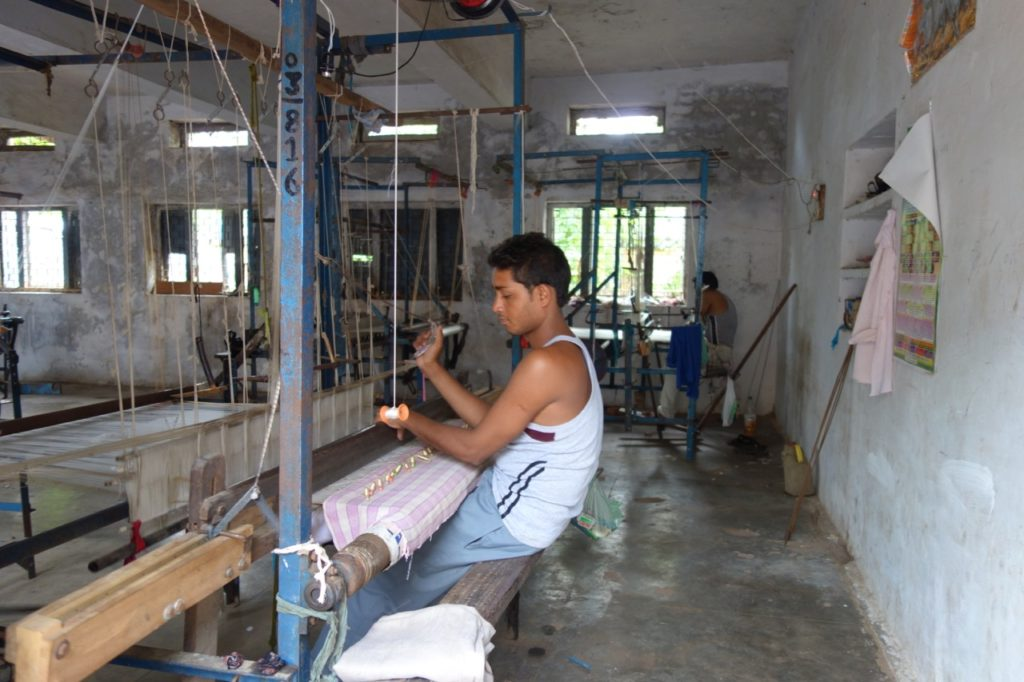 A weaver in the government weaving centre