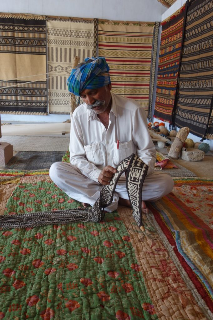 Tejsi showing us a ply-split braided camel belt